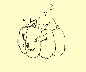 cat dreaming in cat jack-o-lantern