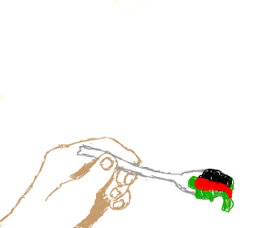 Hand w/large spoon of red/green/black stuff