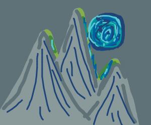 Moon rising over a mountain