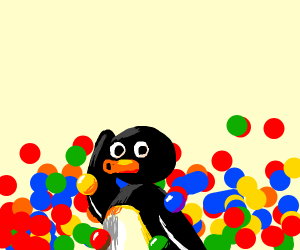 A Penguin plays in a ball pit