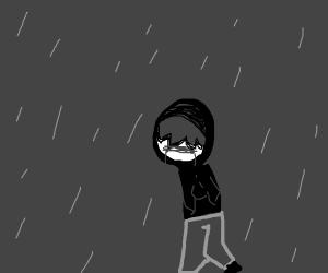 Emo boy crying in the rain