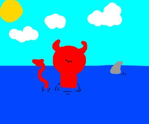 demon has fun swimming in the ocean