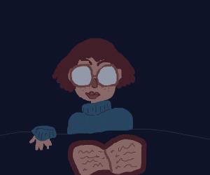 Short hair sweater girl reads a book