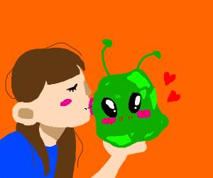 Girl kissing alien rock