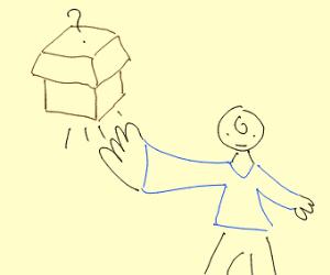 man with blue shirt has an open box