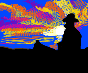Cowboy watches the sunset