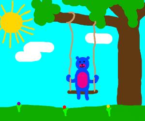 Blue teddy bear on a swing