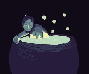 Sad man in giant cauldron