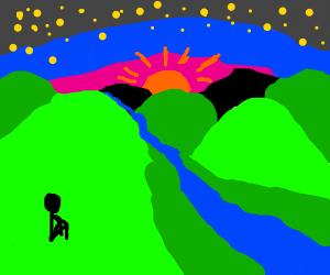 boy sitting by sunset