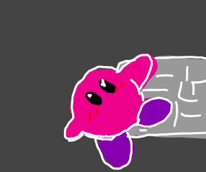 Kirby clinging on a sidewalk