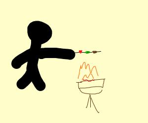 Stick figure grilling kebabs