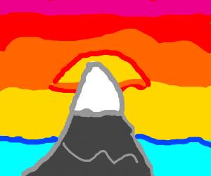 Sun setting behind a mountain