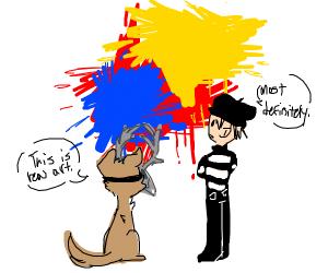 dog w/ deer skull on head admires paint splat