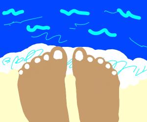 Feet by the ocean