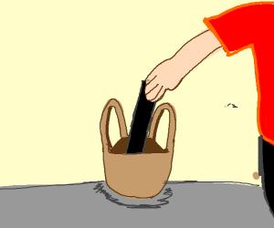 black censored bar goes into tan shopping bag