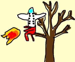 planeman shoot fire frm head is stuck in tree