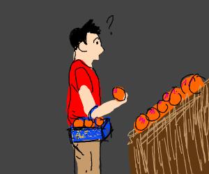 Man shopping for peaches