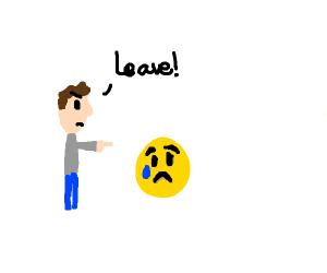 Man telling the sad emoji to leave