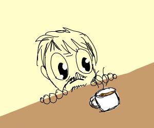 man with huge pupils stares at coffee mug