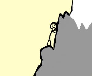 guy climbing mountain
