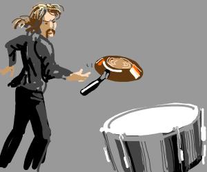 throwing pan at a drum