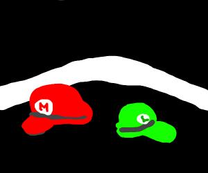 Mario and luigi hats on the floor