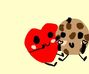Heart shape hugs a cookie
