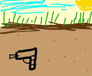 A gun hidden underground