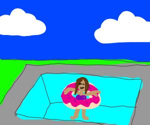 Girl in doughnut pool floaty