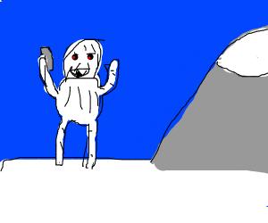 Yeti taking selfie at the mountains