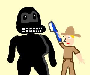 man brushing gorillas teeth