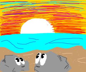 Rocks watch sunset on beach