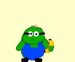 green minion holding banana