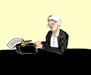 Old man using a typewriter