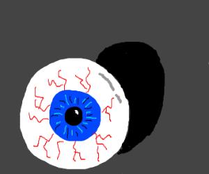 Blue eyeball on the floor