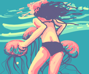 Woman swimming with jellyfish