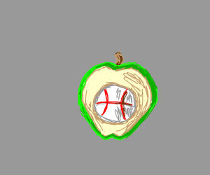 Baseball within a green apple