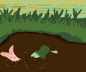 Mermaid swims in a swamp