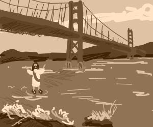 Man walks under bridge (maybe golden gate?)