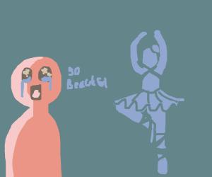man cries in awe as a ballerina dances