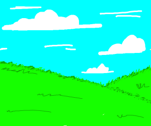 A grassy hill and blue sky