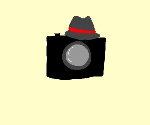 Camera wearing a fedora