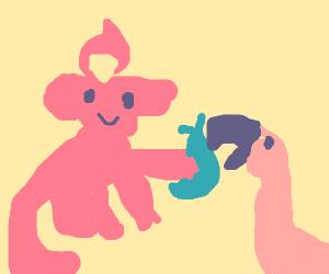 Pansear feeds a flamingo