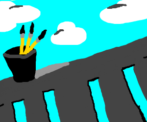 Cup with 3 pencils on a railing