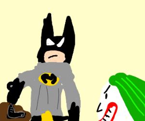 Batman grabs a gun