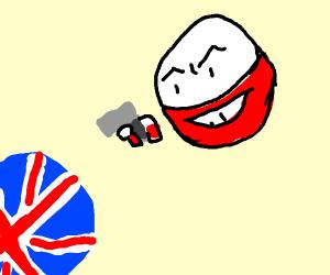 Electrode holds a gun up to british ball