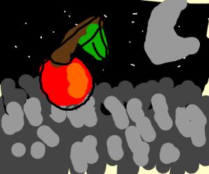 lone red cherry lying on grey grass at night