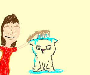 Woman bathing her cat using a scrub brush :)