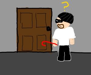 Burglar stopped by door.
