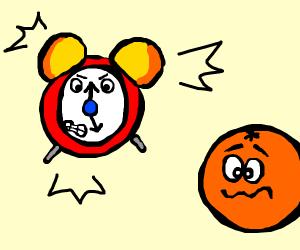 An alarm clock annoying an orange.
